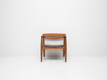 single chair in an empty white room