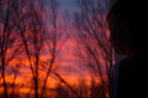 a boy at sunset