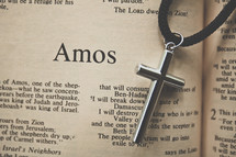 Amos and a cross necklace