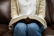 a woman reading with a Bible in her lap