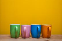 row of mugs