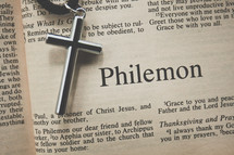 Philemon and a cross necklace