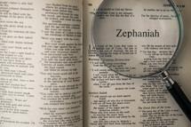 magnifying glass over Bible - Zephaniah