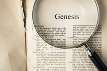 magnifying glass over Bible - Genesis