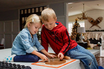 kids making Christmas cookies