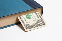 dollar bookmark in a book