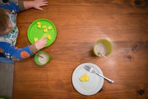 toddler boy eating food