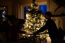 kids in front of a Christmas tree