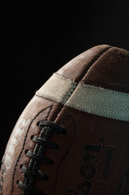leather football in darkness