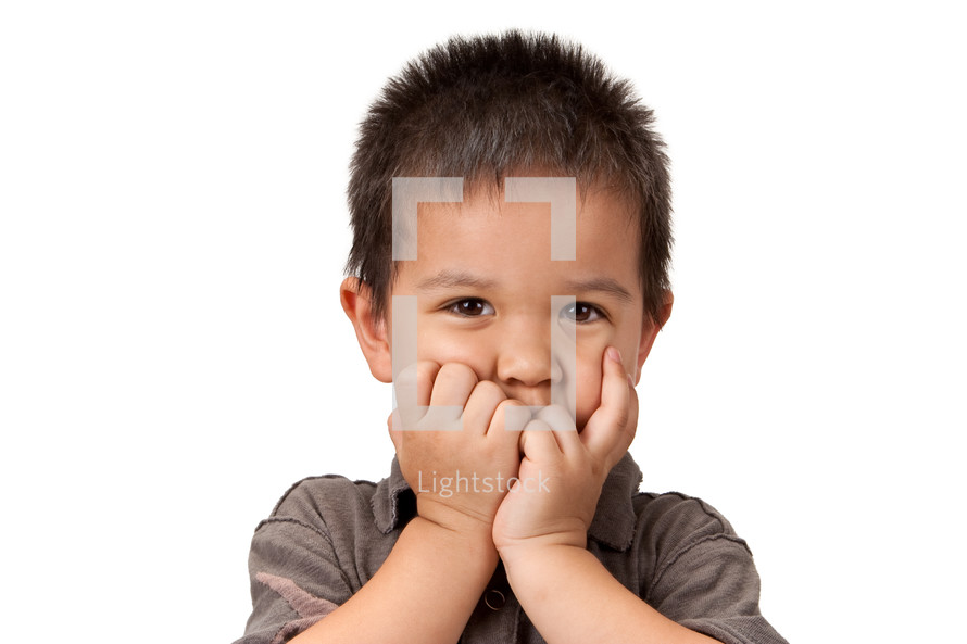 hands on the face of a child