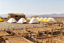 tents and cots for refugees in Africa