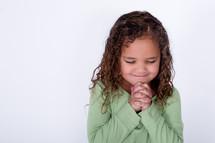 Happy girl praying.