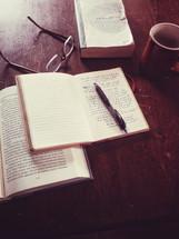 book, Bible, pen, journal, Bible study, reading glasses, mug, table