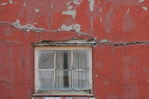window and a crack in a wall