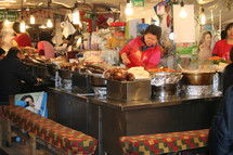 woman cooking in a restaurant in Korea