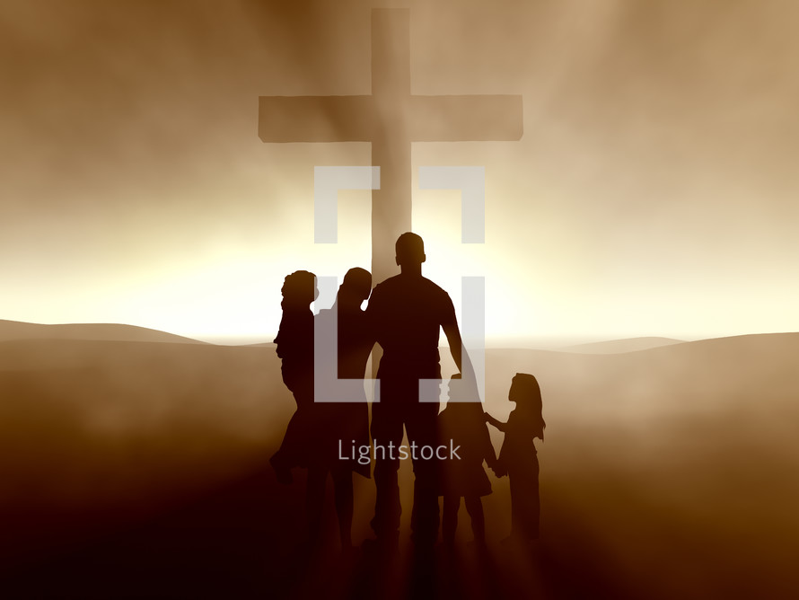 Silhouette of a family around the cross at dusk.