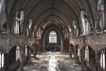 Shot of the sanctuary of a  deteriorating and abandoned church.