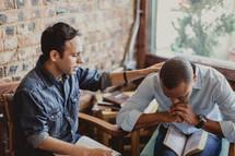 men reading Bibles at a Bible study
