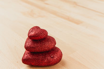 stack of three red hearts