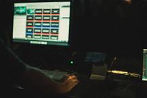 man controlling a soundboard