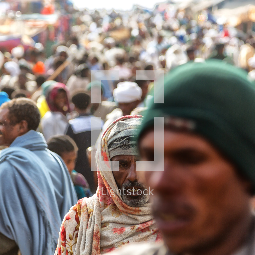 people in a crowded market in Ethiopia