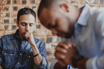 men praying at a prayer group