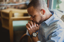 African-American man in prayer