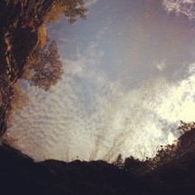 Looking at the sky from a hole in the ground.