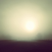 foggy sunrise over a highway