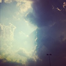 Sun beamning through storm clouds.