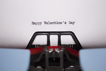 words Happy Valentine's Day typed on a typewriter