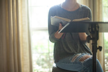 A woman leading a Bible study.