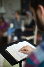 man leading a discussion at a home Bible study