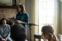 A young woman leads a home Bible study.
