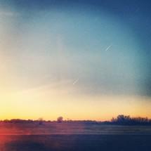 field on flat land under at dusk