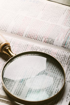 magnifying glass over Bible verse