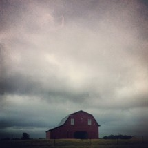 stormy sky over a red barn