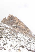 jagged mountain peak with snow
