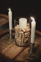 Unity candle set on top of wine corks