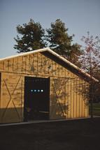 A barn with open sliding door