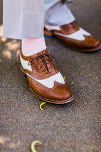 brown and white wing tip dress shoes men fashion clothing