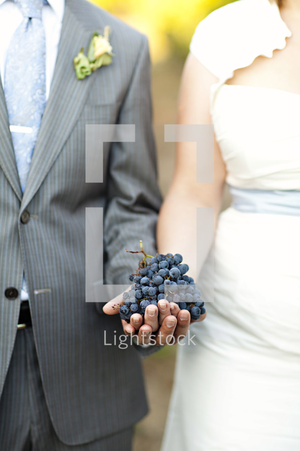Couple holding bunch of grapes wedding marriage two become one