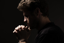 a man with praying hands.
