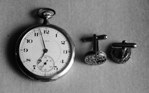 A pocket watch and cuff links.
