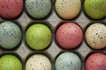speckled Easter eggs in an egg carton