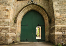 green arched doors
