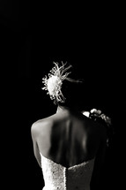 Back of bride in dress dramatic light hair piece