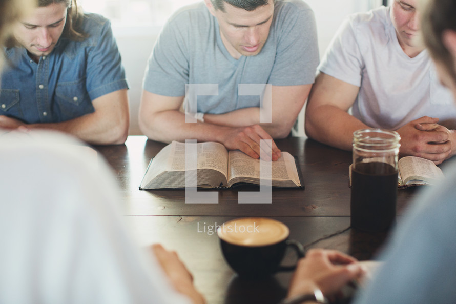 men reading Bibles at a men's group Bible study
