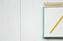 a pencil on a notepad.