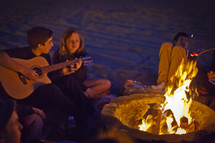 singing by a campfire